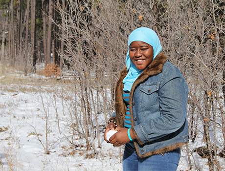 YES exchange student from Ghana forming a snow ball for the first time in her host state Arizona
