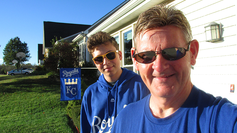 FLEX student from Moldova with his Missouri host dad wearing matching Kansas City Royals sweatshirts