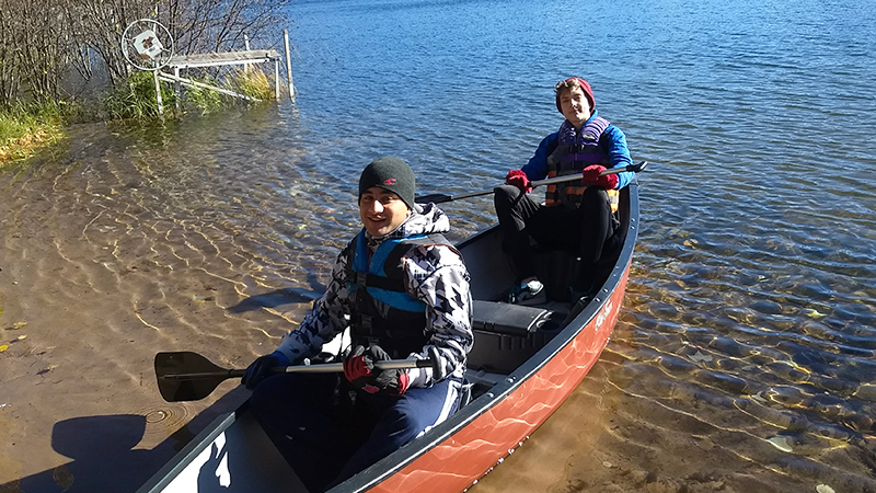 Kennedy Lugar Youth Exchange and Study program participant from Pakistan canoeing with his host brother from Minnesota