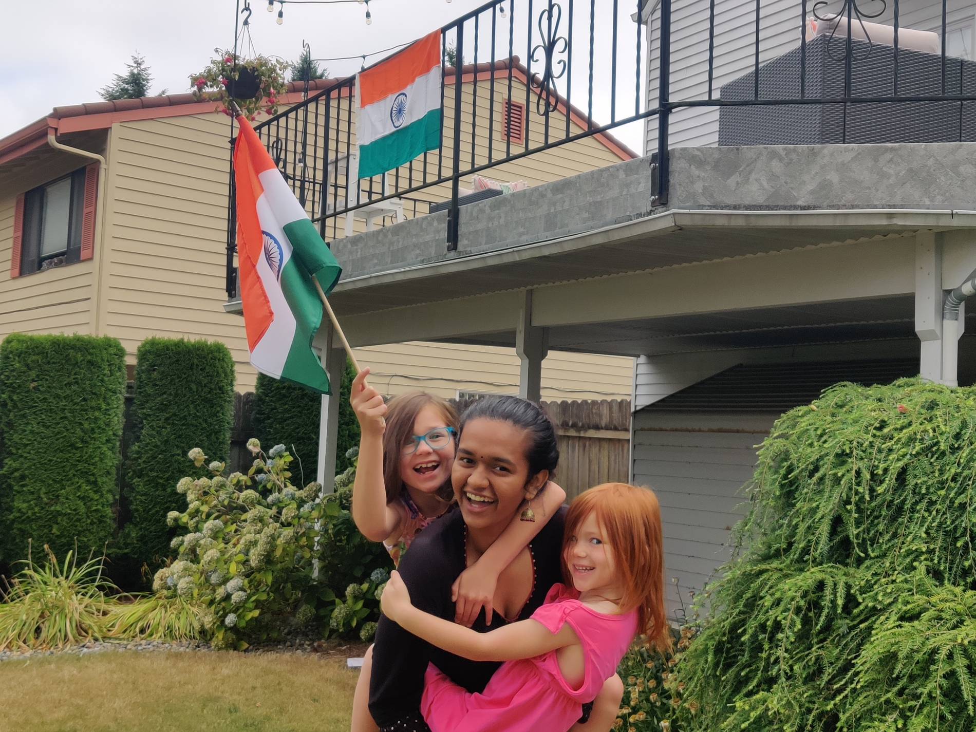 Indian Exchange Student and Young Host Sisters