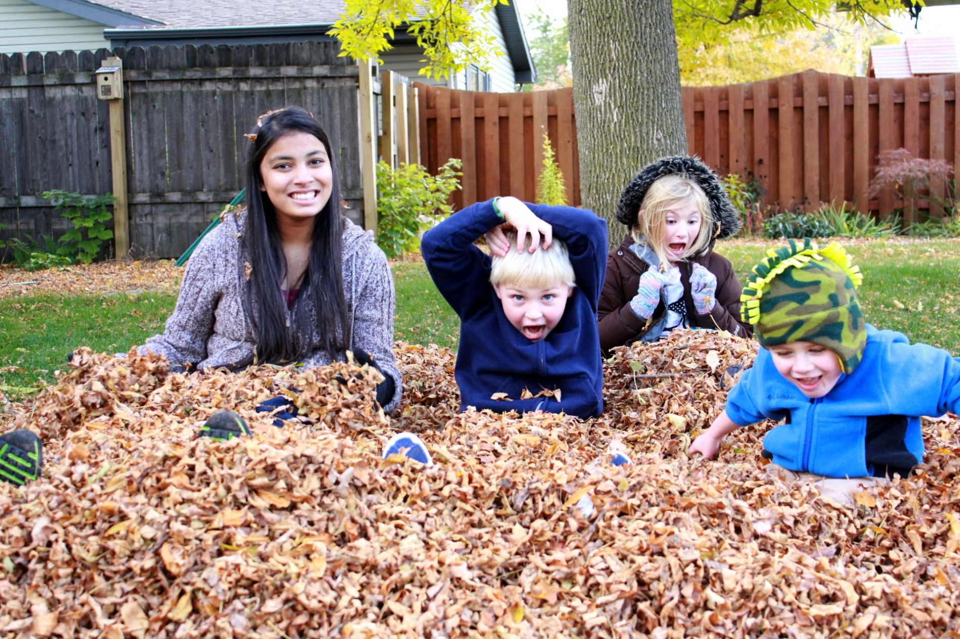 PAX Exchange Student from Pakistan Playing in Leaves with Young Host Siblings