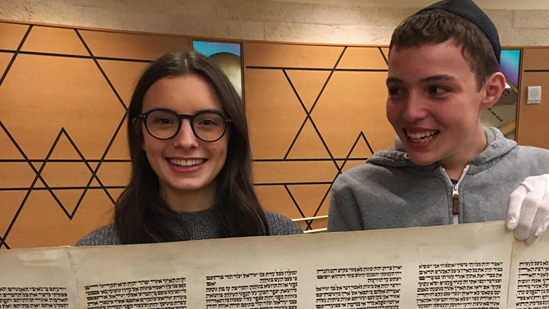 PAX exchange students from Italy and Germany hold a section of the Thora after Jewish service in Nevada
