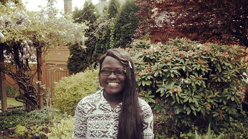 Young woman from Kenya in the garden - high school exchange student in Washington