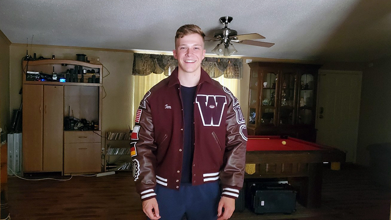 German exchange student football player in varsity jacket in Texas