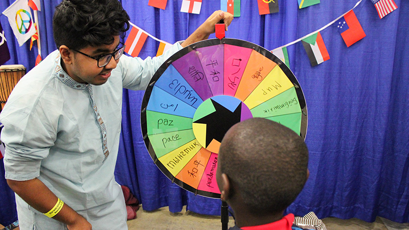 YES student from Bangladesh answers questions about his home country at an event in Indiana during International Education Week