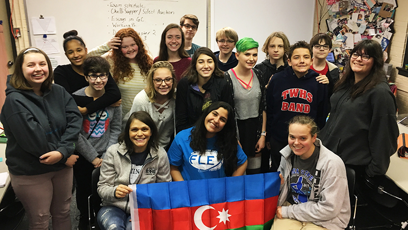 FLEX exchange student from Azerbaijan with her American classmates holding the Azerbaijani flag at their Ohio school