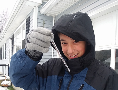 PAX exchange student from Maine holding an icicle