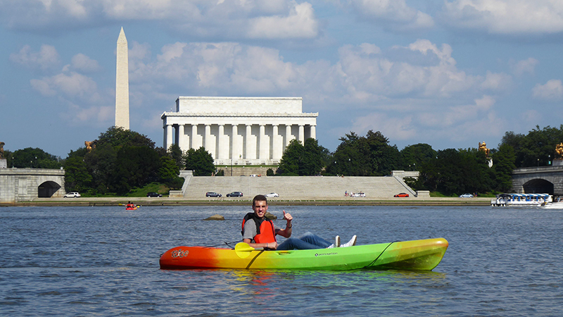 YES program participant from Egypt kayaking on the Potomac River during a trip to Washington, D.C. with his host family