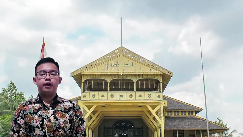 Indonesian exchange student in front historic building in West Borneo