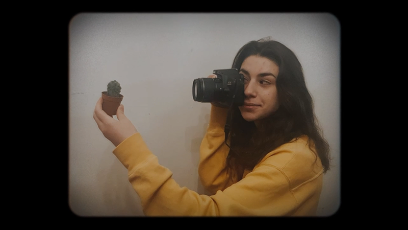 Georgian exchange student photographs a handheld cactus