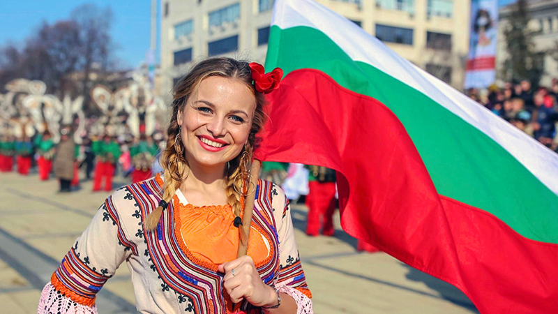 Bulgarian woman at parade with flag