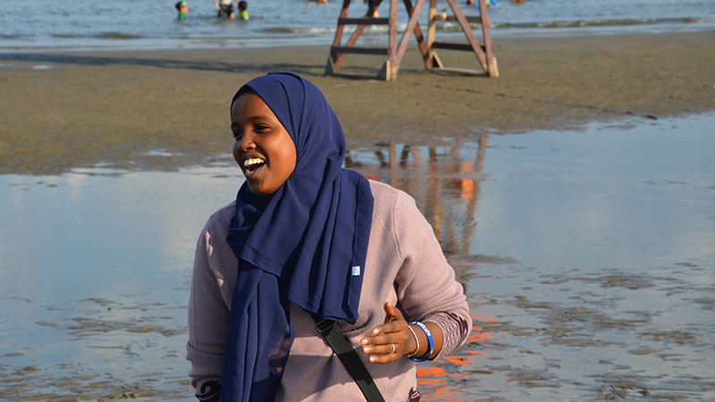 Young woman from Somaliland laughing on New York City beach