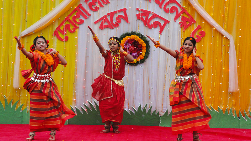 Bengali girls dancing at a festival