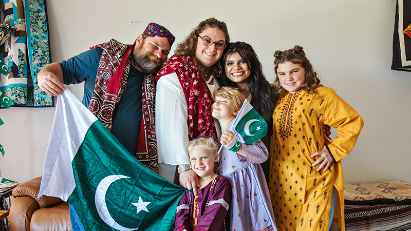 Pakistani exchange student dressed in traditional clothing with American host family