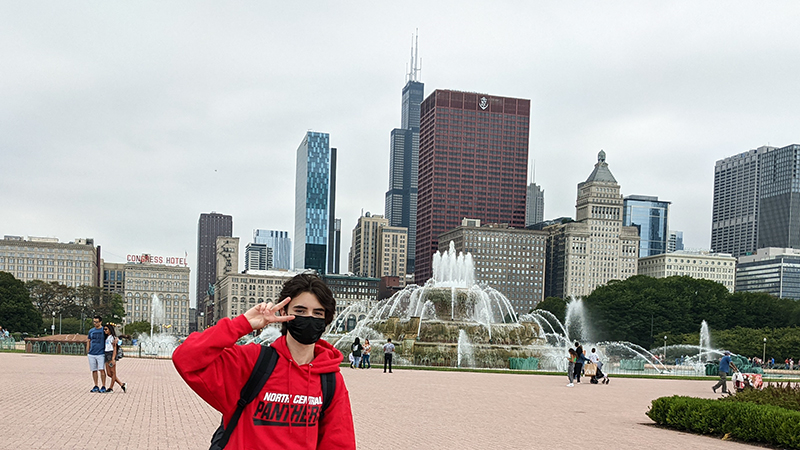 French exchange student gives the peace sign in front of Buckingham Fountain