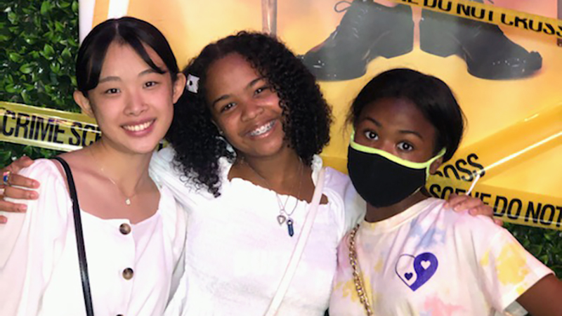 Exchange student from Japan poses with host sisters