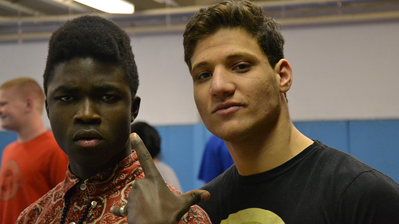 YES exchange student from Tunisia with a teammate in their high school's wrestling room