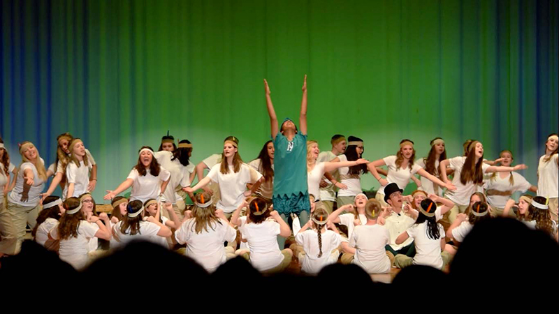 PAX student from Pakistan performing as Peter Pan in a school musical in Massachusetts